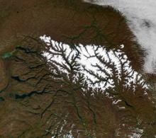 Snow blankets the volcanic landscape of the Putorana Plateau in central Siberia